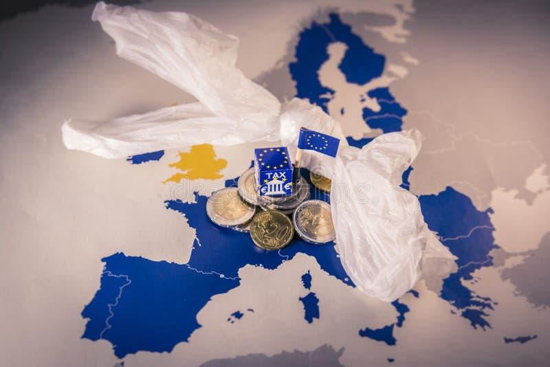 EU map with euro coins and a plastic bag symbolizing european plastic tax regulation. EU map with euro coins and a plastic bag symbolizing european royalty free stock photos