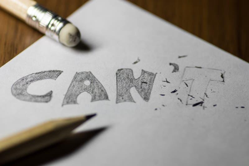 Eu posso o ` t, escrito no lápis com o t apagado imagens de stock