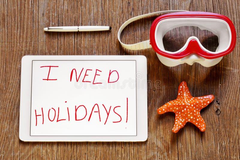 Eu preciso feriados em uma tabuleta e uma máscara do mergulho e uma estrela do mar imagens de stock royalty free