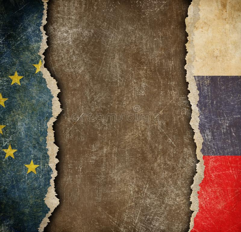 EU and Russian torn paper flags. Break of diplomatic relations. EU and Russia break of diplomatic relations royalty free stock photography
