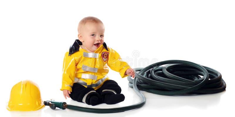Eu sou um bombeiro. Piscadela! imagens de stock royalty free