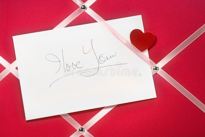 Eu te amo placa da escrita do cartão da mensagem imagens de stock