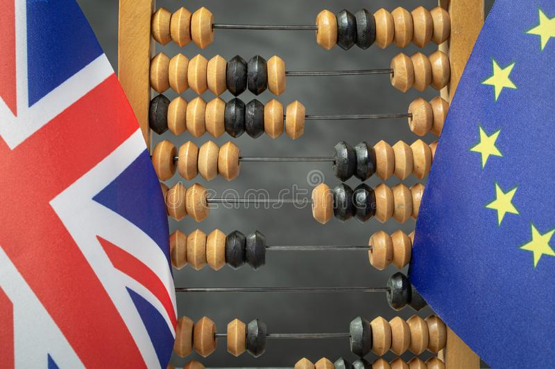 EU and UK flags with abacus. Brexit trade compensation and the mutual financial claims concept stock photos