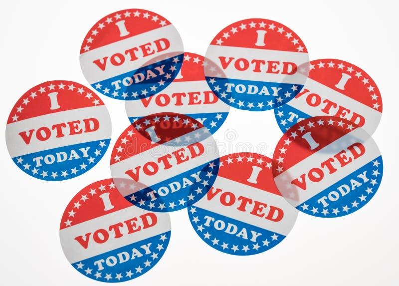 Eu votei hoje as etiquetas de papel no fundo branco foto de stock