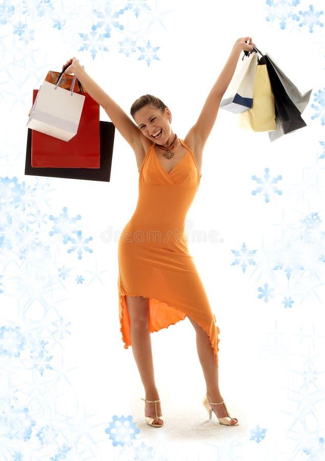 Euforia de las compras con los copos de nieve imagen de archivo