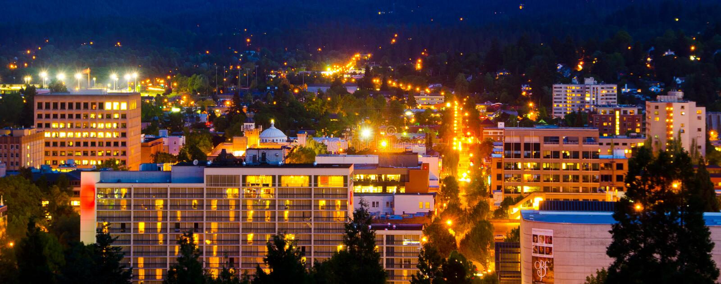 Eugene horisont på natten royaltyfri foto
