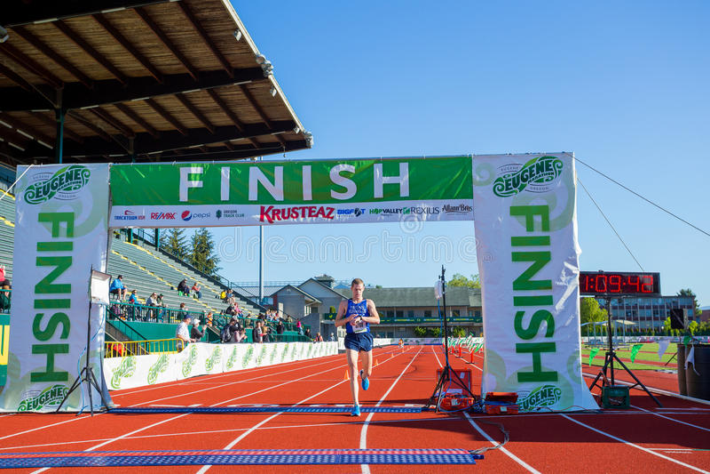 2016 Eugene Marathon. EUGENE, OR - MAY 1, 2016: Elite runner coming to the finish line for the half marathon distance at the 2016 Eugene Marathon, a Boston stock photo