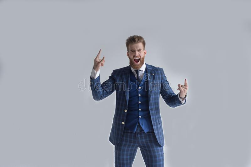 Euphoric happy businessman wear suit celebrate mobile win, excited overjoyed lucky executive winner receive good news rejoice bet stock photo