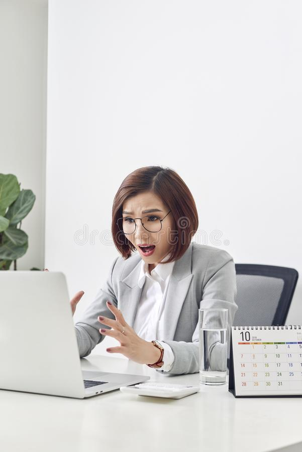 Euphoric and surprised winner online watching a laptop at office, Beautiful young woman glad and surprised after open email on stock photography