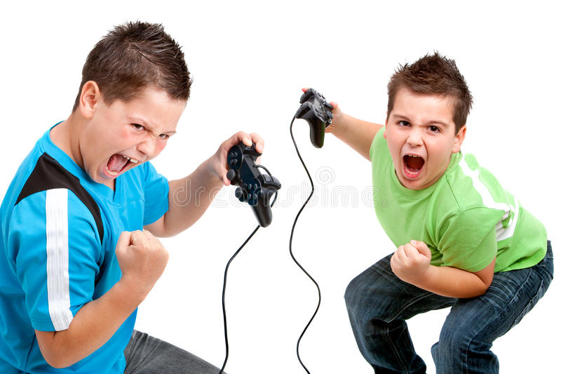 Euphorious boys playing with video consoles royalty free stock photography