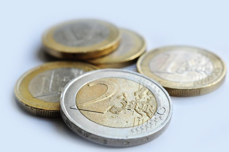 Eur coins currency. Two Eur coins on white background, european currency money in detail stock images