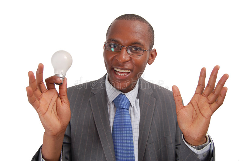 Eureka!!!. This is an image of a man having a eureka moment. He has discovered a solution to a major problem. (Designers can add lighting to the bulb royalty free stock image