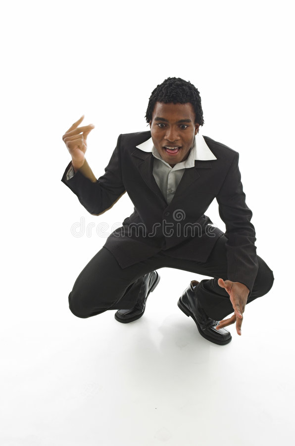Eureka!. Attractive young black guy in smart business suit has a eureka moment stock image