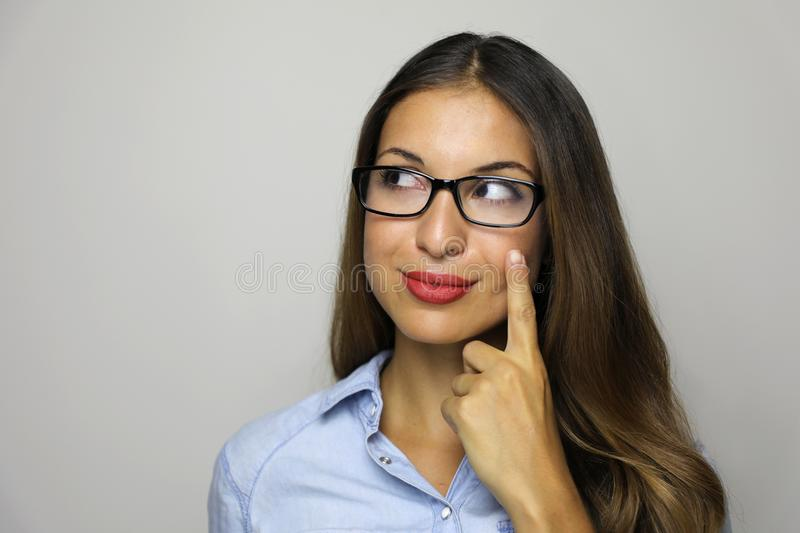 Eureka! Close-up portrait of charming young businesswoman had an idea pointing with finger and looking to the side isolated. On gray background stock photography
