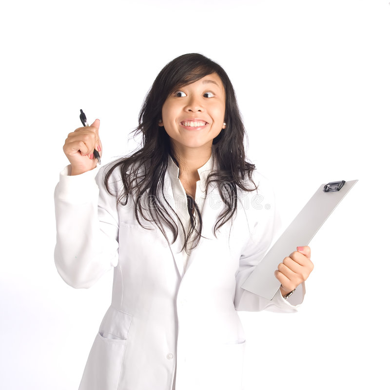 Eureka Moment. Young smiling happy woman in white overalls and holding a clip board having a Eureka moment stock photography
