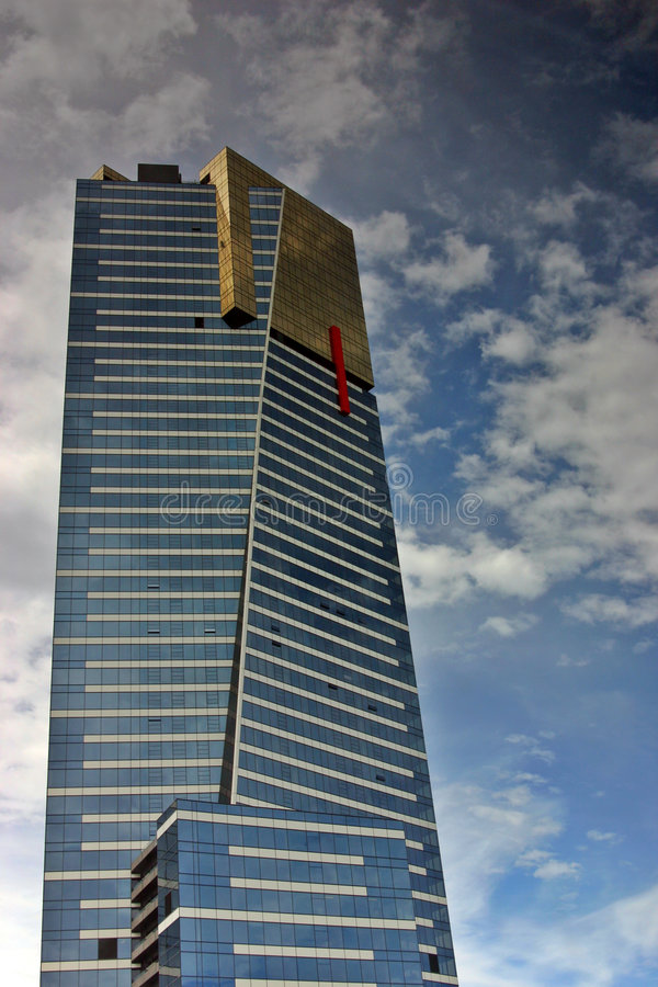 Eureka Tower. Located in Melbourne, Victoria, Australia. Isolated against a blue sky and clouds background stock photo