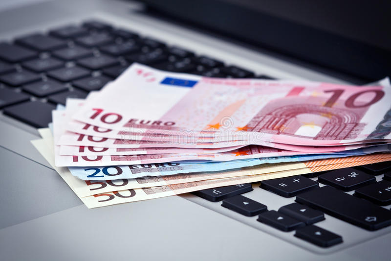 Euro bank notes on keyboard royalty free stock photos