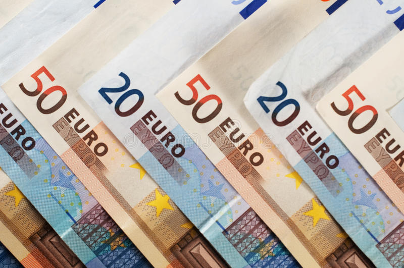 Euro bank notes. A selection of twenty and fifty euro bank notes royalty free stock image