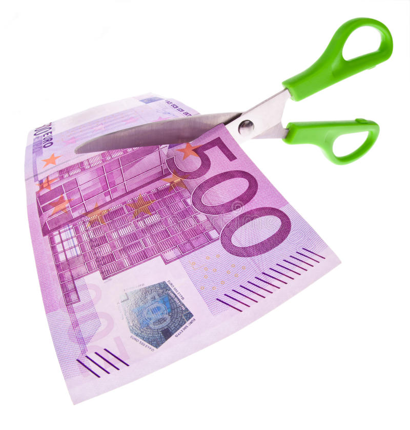 Euro bankbiljetten en schaar stock foto's