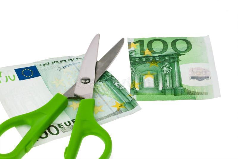 Euro bankbiljetten en schaar royalty-vrije stock foto's