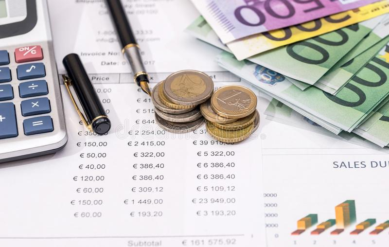 Euro banknote with coin above business graph.  stock photo