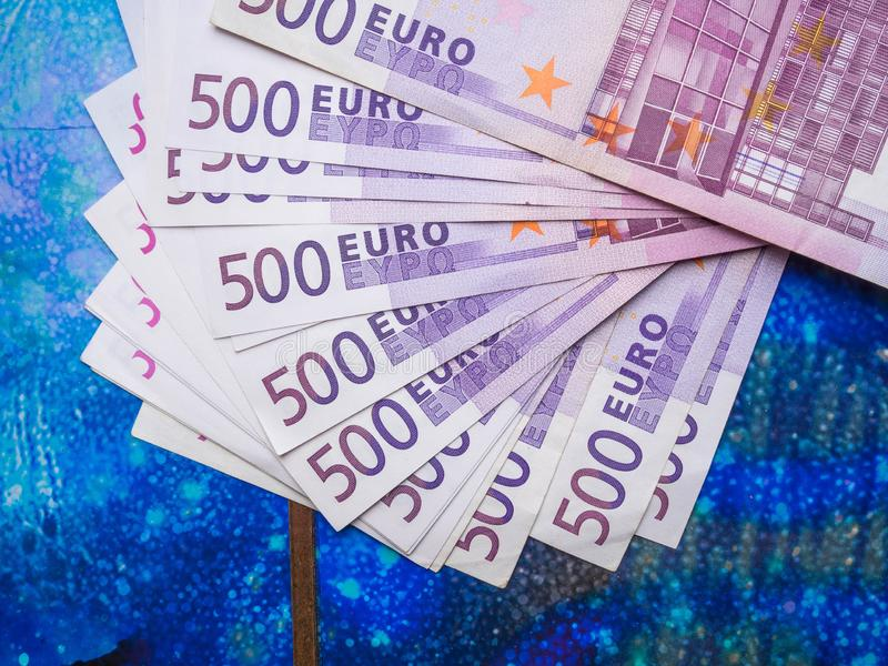 500 euro banknote isolated on blue background, finance concept. cash, close up. 500 euro banknote isolated on blue background, finance concept. cash royalty free stock photo