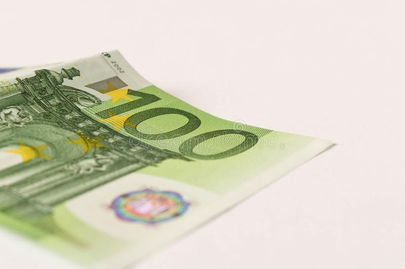 100 Euro banknote on a light background. Close up. The concept of savings.  royalty free stock image