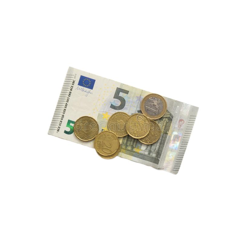 5 euro banknote and small coins. Isolated on white stock photo