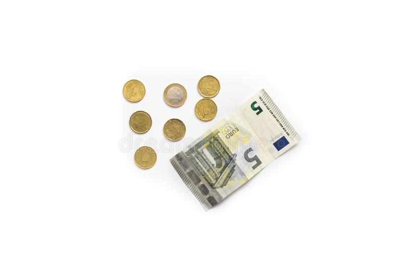 5 euro banknote and small coins. Isolated on white stock photos