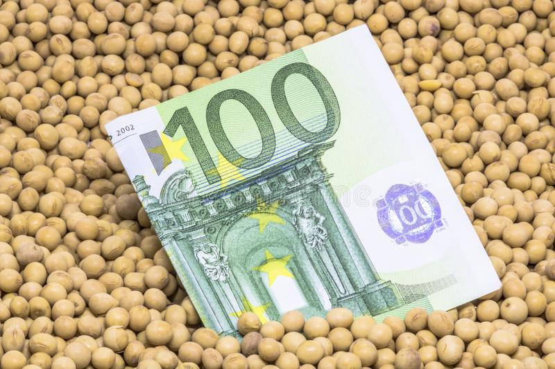 Euro banknote with soybean background. Agricultural concept, soybean at 100 Euro banknote royalty free stock photography