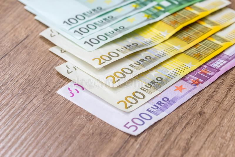 Euro banknote on wooden desk. 100 200 500 euro banknote on wooden desk stock image