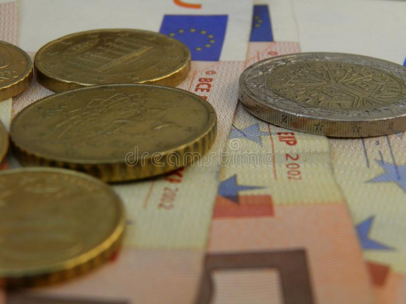 Euro banknotes and coins royalty free stock image