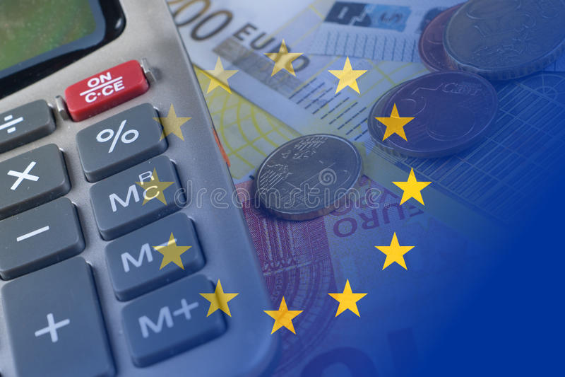 Euro banknotes, coins, calculator, eu flag stock photography