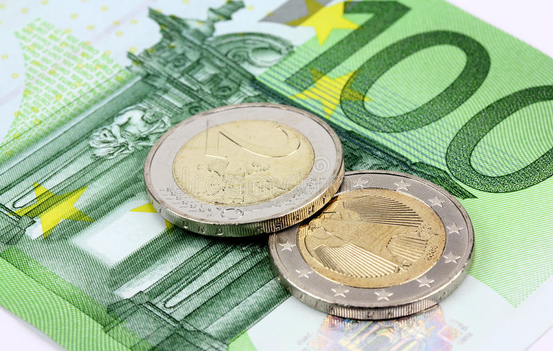 Euro banknotes and coins currency of Europe royalty free stock photography