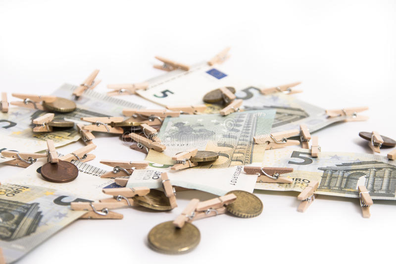 Euro banknotes and euro cents. On a white background royalty free stock photography