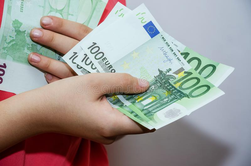 euro banknotes in female hands close-up. Business woman holds hands euro. royalty free stock photos
