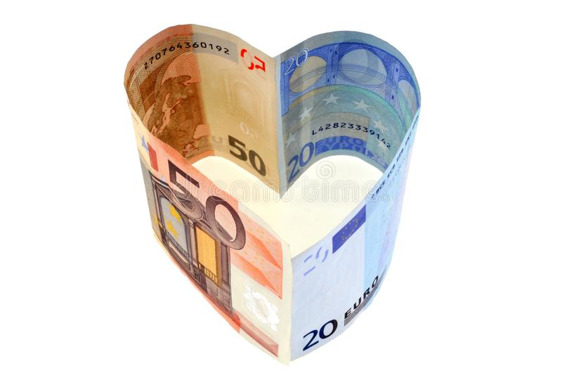 Euro banknotes in heart shape on white background royalty free stock photo
