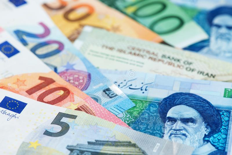 Euro banknotes with Iranian Rial currency. SPV EUR IRR. Euro banknotes with Iranian Rial currency. Europe Iran money EUR to IRR SPV Germany France UK Oil Gas royalty free stock photography
