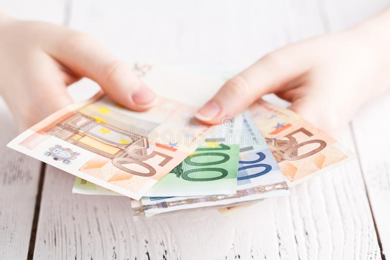 Euro banknotes money in female hands royalty free stock photo