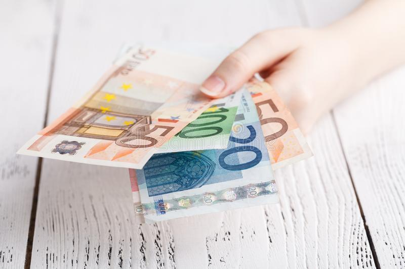 Euro banknotes money in female hands stock photography