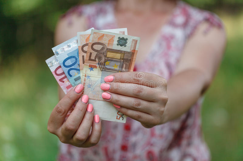 Euro banknotes in woman hands royalty free stock photo