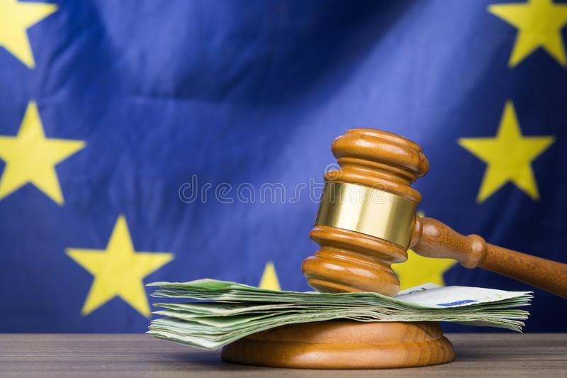 Euro banknotes with a wooden court gavel against european union stock photos