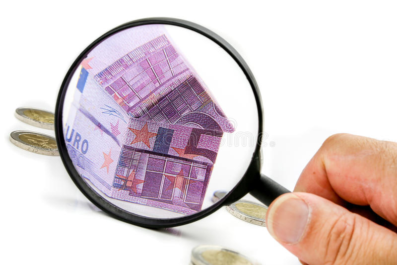 Euro bill House and expenses under magnifying glass stock images