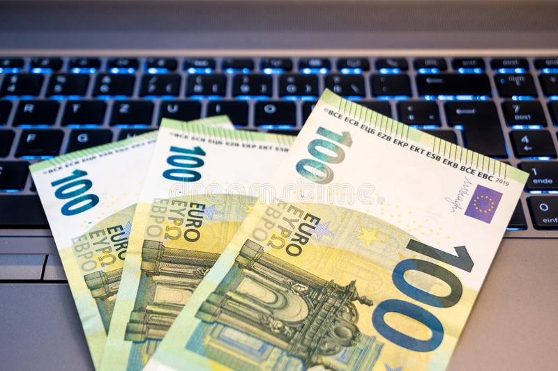 100 Euro Bills on Keyboard - Home Office Income Concept royalty free stock images