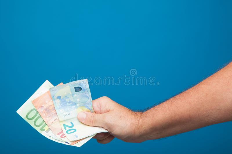 Euro bills in the right hand of a person royalty free stock photography