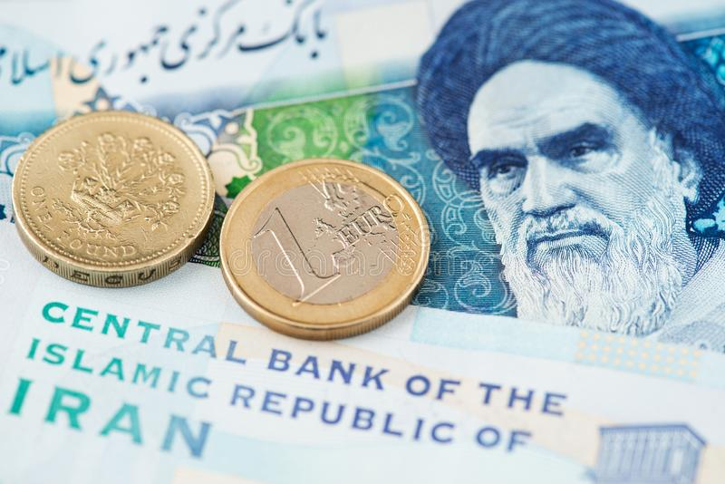 Euro and British Pound Sterling with Iranian Rial banknotes. Europe Special Purpose Vehicle Iran. SPV Europe UK Iran Euro Pound Rial Currency US sanctions on stock images