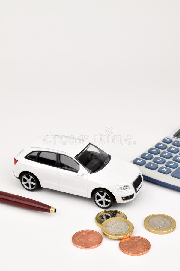 Euro Car Money. A white car on a white background with Euro coins and calculator stock image