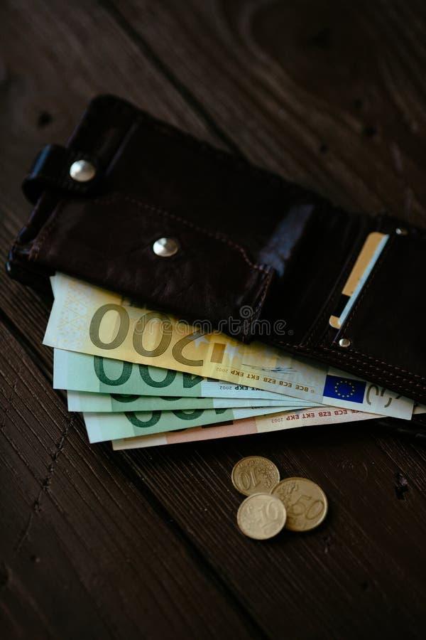 Euro cash inside brown wallet stock photos