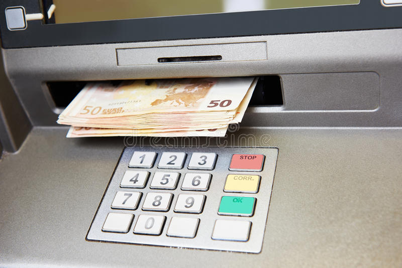 Euro cash withdrawal. Cash withdrawal. Euro banknotes in ATM stock photography