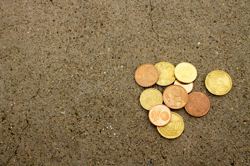 Euro cents on the cement floor. Ten coins euro cents on the cement floor with the texture royalty free stock images